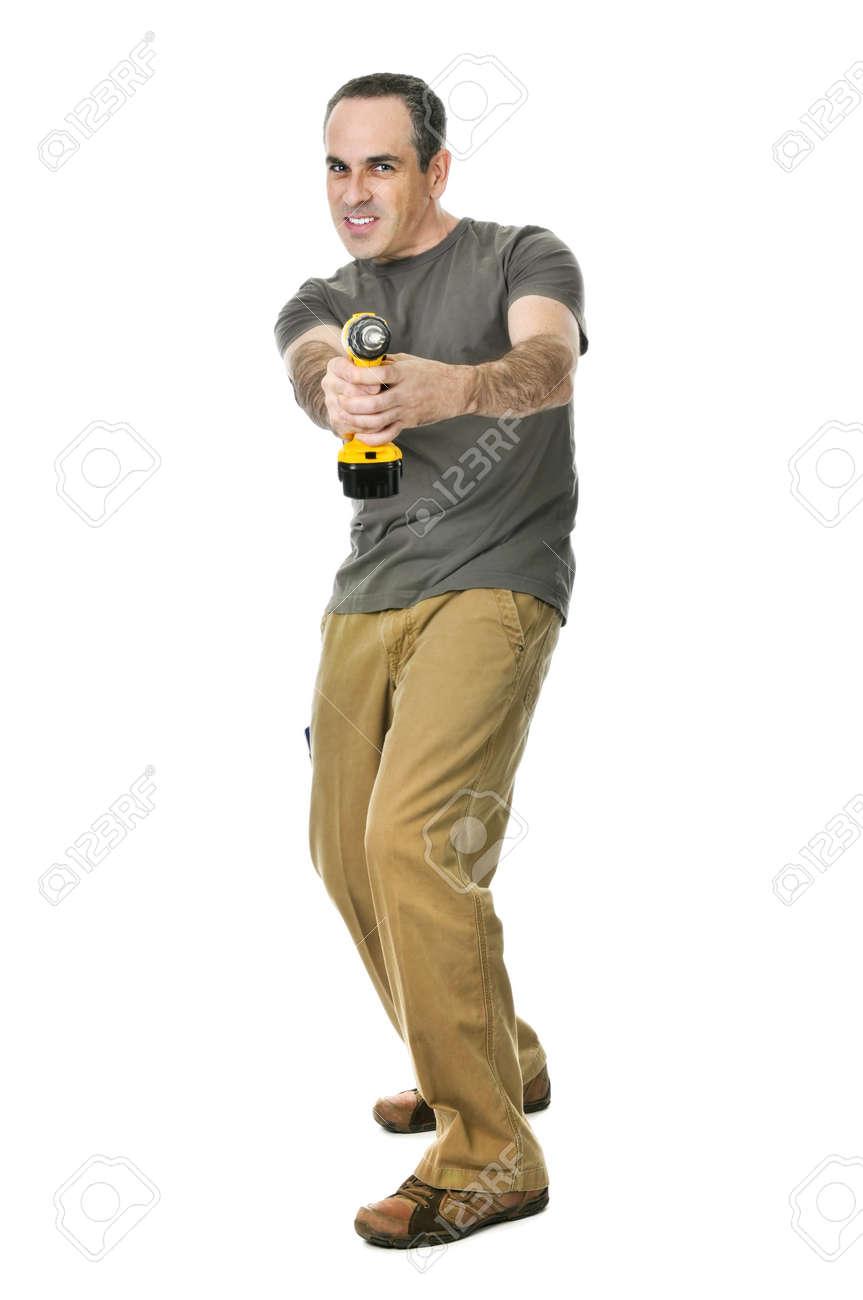 Fierce handyman aiming his cordless drill like a gun Stock Photo - 4160291