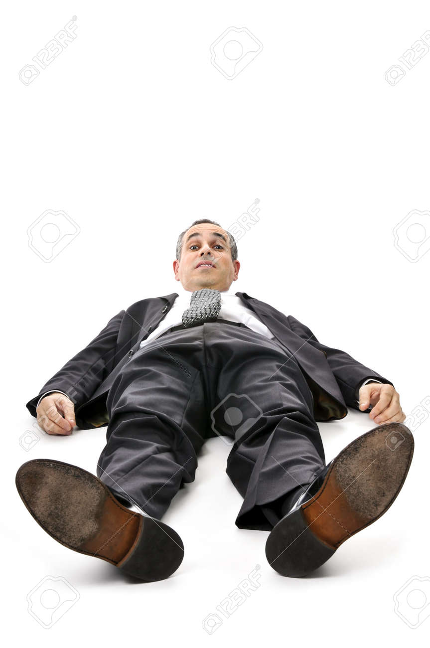 Scared businessman laying down in a suit isolated on white background Stock Photo - 4212349