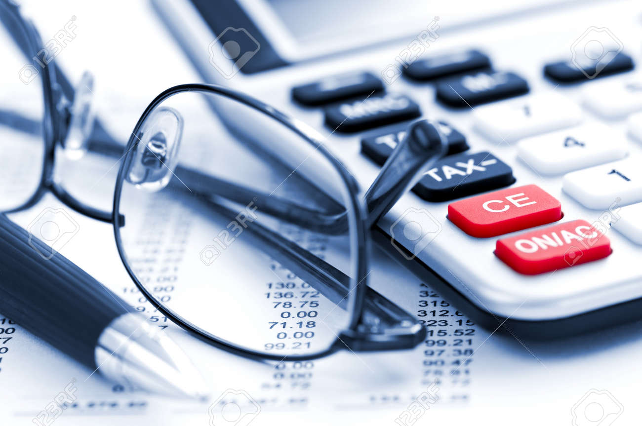 Calculating Numbers For Income Tax Return With Glasses Pen And – Income Tax Calculator