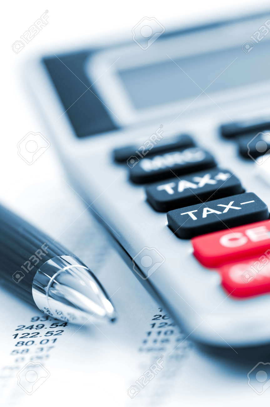 Calculating Numbers For Income Tax Return With Pen And Calculator – Income Tax Calculator