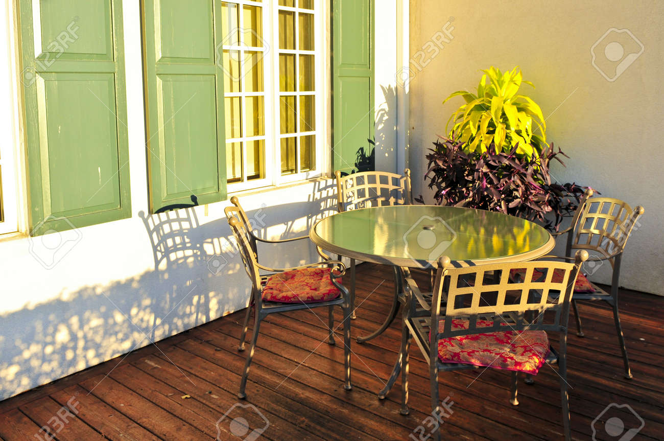 Patio chairs and tables on wooden patio deck Stock Photo - 4441503