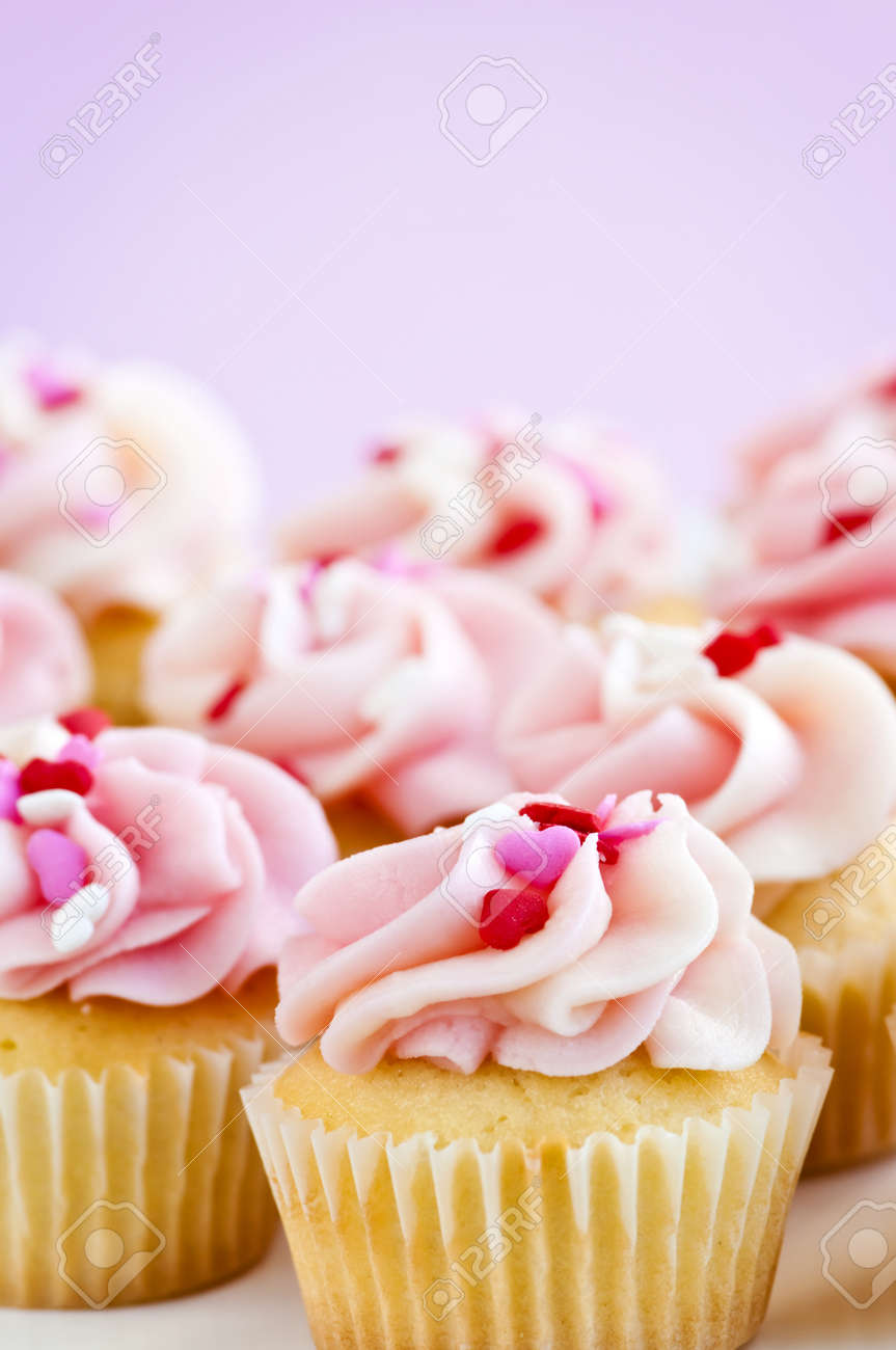 Lots of tasty cupcakes with icing and sprinkles Stock Photo - 4484546