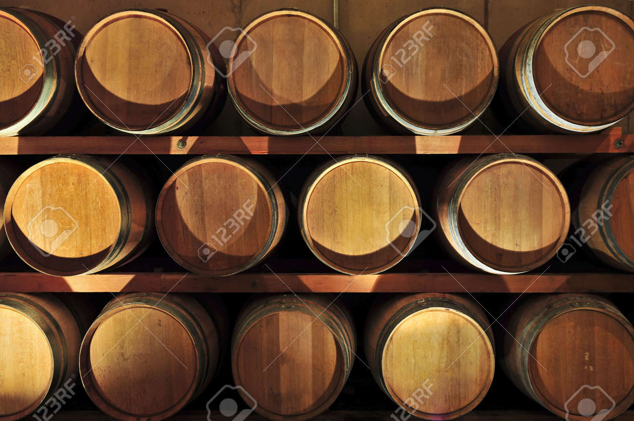 oak wine barrels. stacked oak wine barrels in winery cellar stock photo 4616872 l