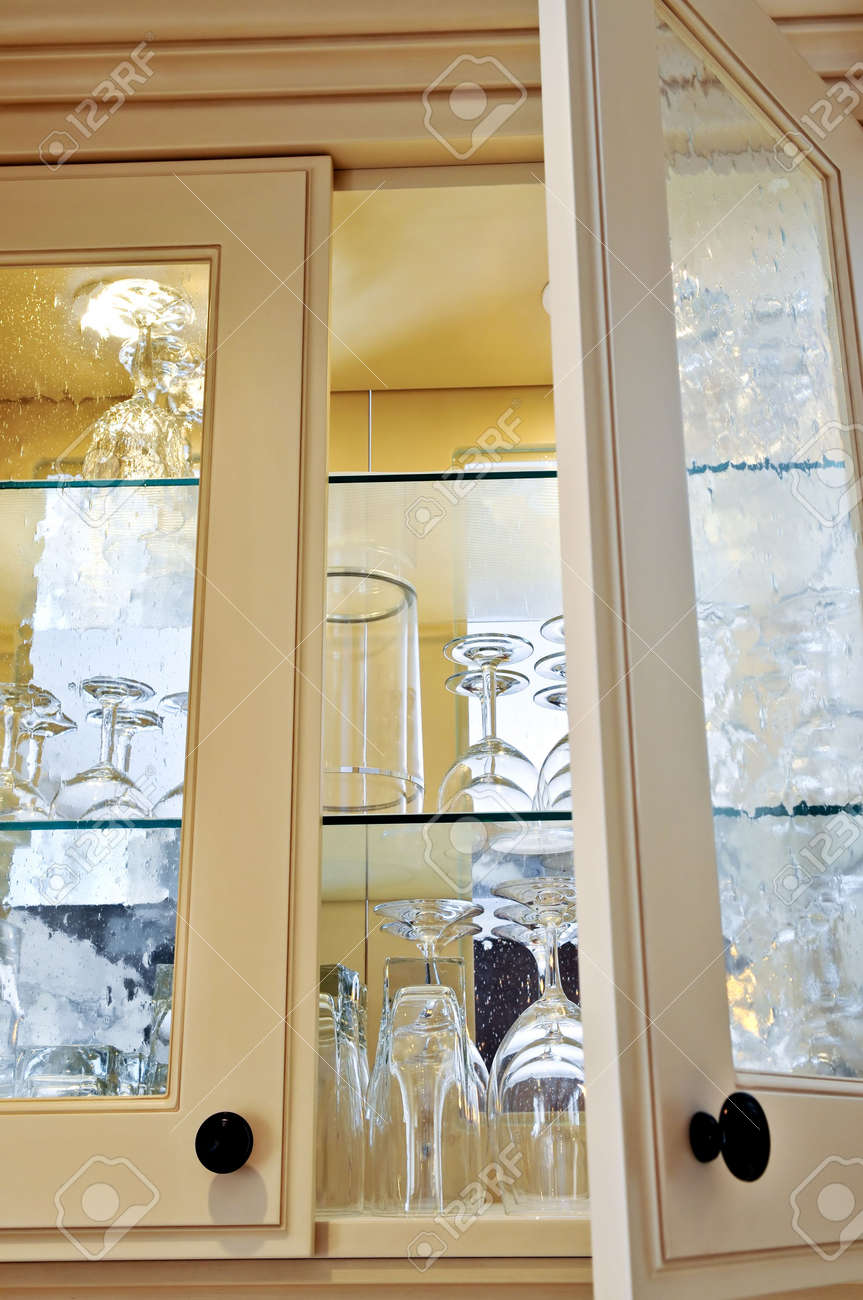 Kitchen Cabinet Close Up With Glass Shelves And Glasses Stock ...