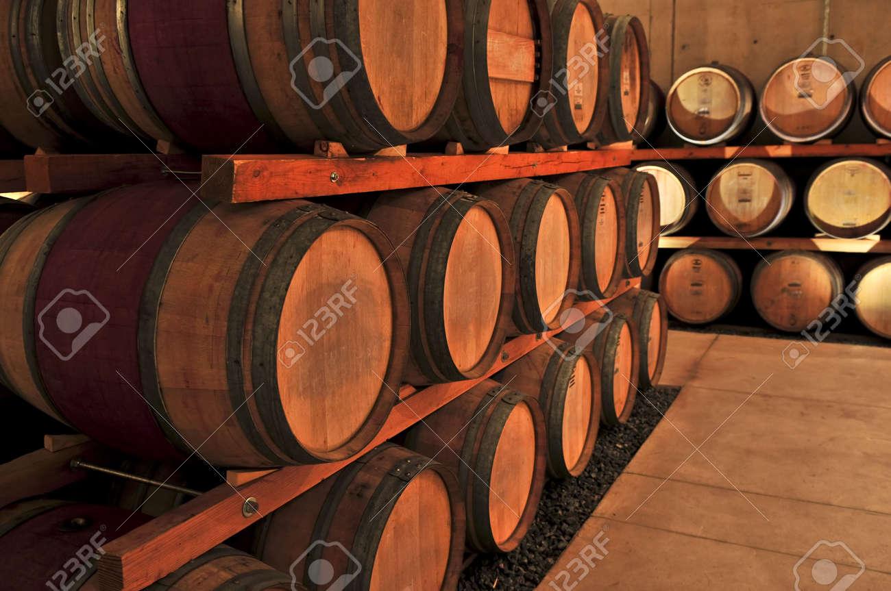 stacked oak barrels maturing red wine. Oak Wine Barrels. Stacked Barrels In Winery Cellar Stock Photo - 4687997 E Maturing Red