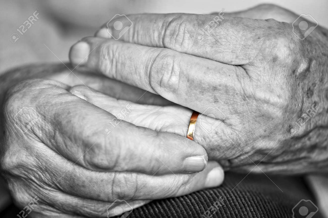 Close up on elderly woman hands with golden wedding ring Stock Photo - 4710532