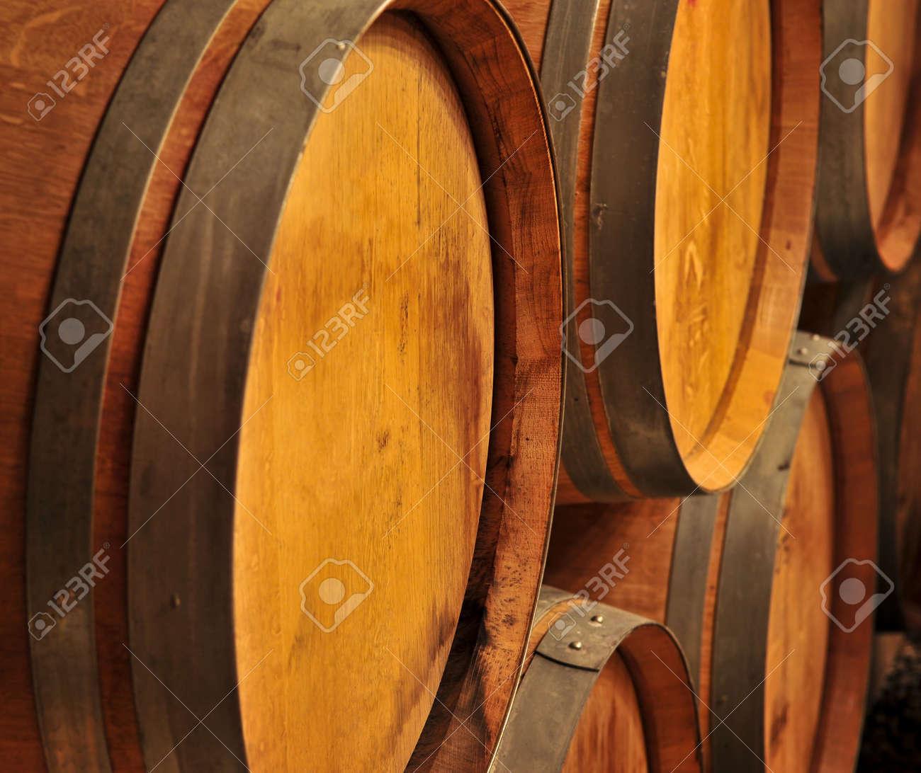 Stacked oak wine barrels in winery cellar Stock Photo - 4710534