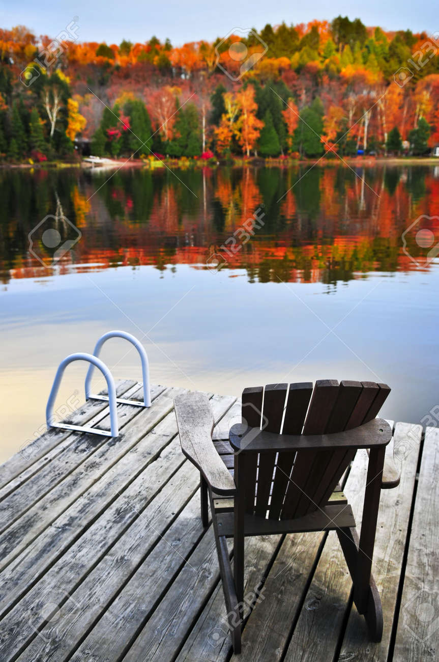 Wooden dock with chair on calm fall lake Stock Photo - 5139549