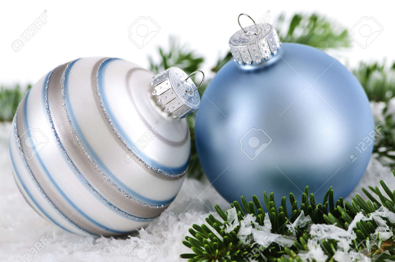 Two Christmas decorations in snow with pine branches Stock Photo - 5244971