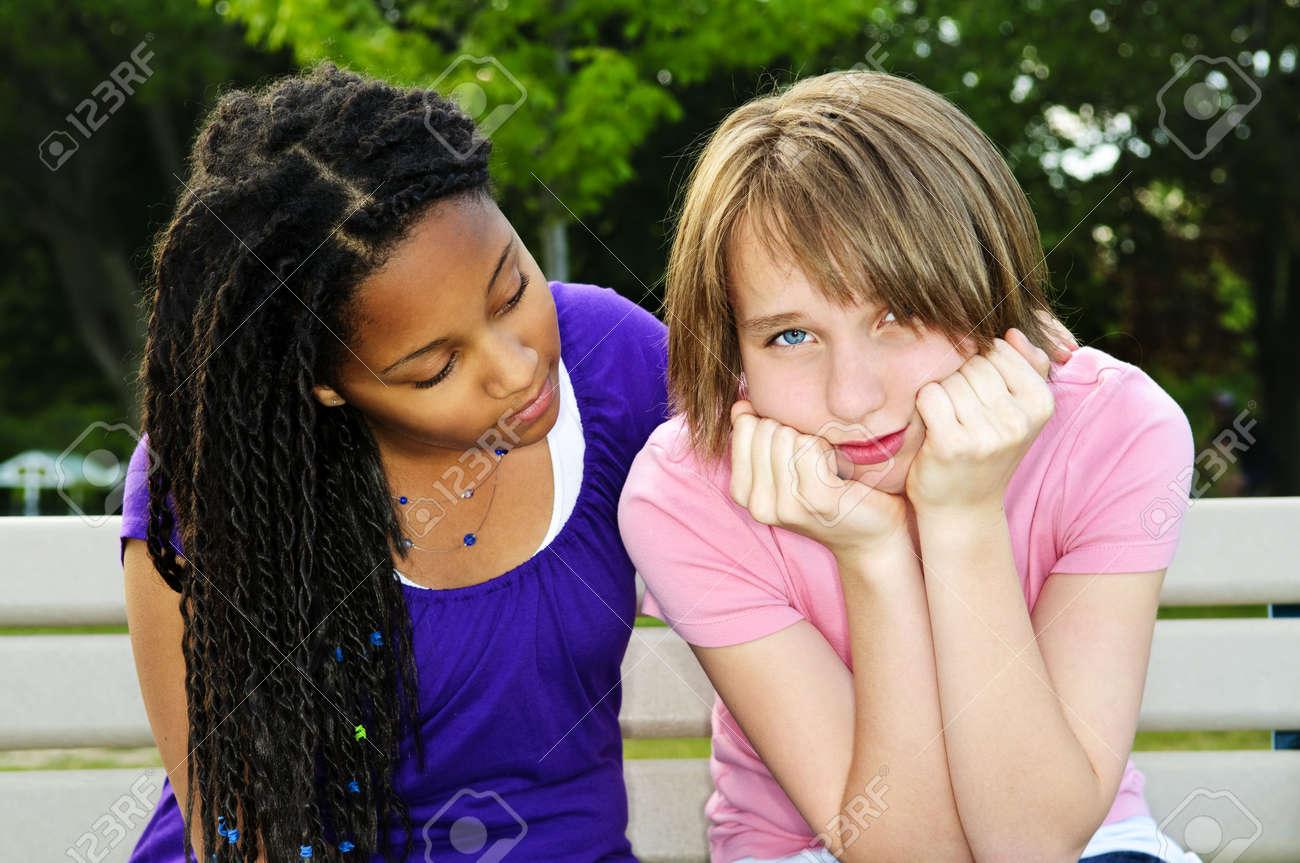 Teenage girl consoling her sad upset friend Stock Photo - 5343636
