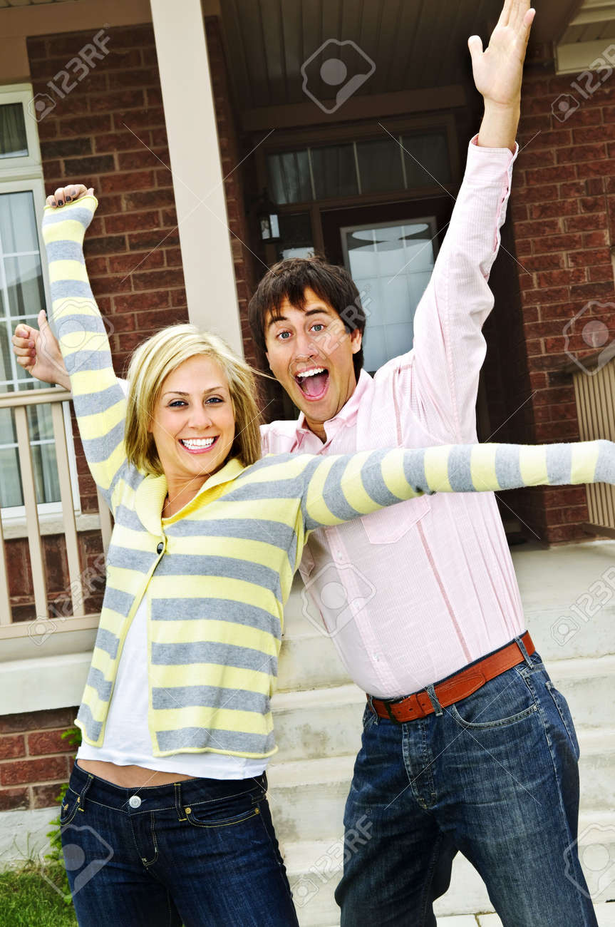 Young excited couple celebrating in front of home Stock Photo - 5395626