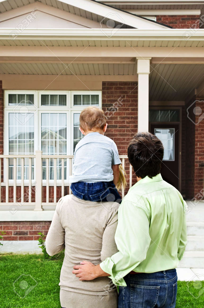 Young happy family shopping for new home - 5395771