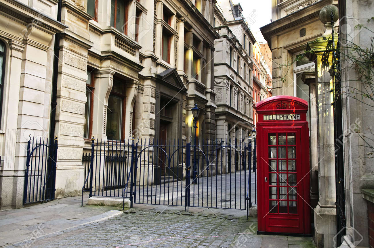 Red Telephone Box Near Old Buildings In London Stock Photo