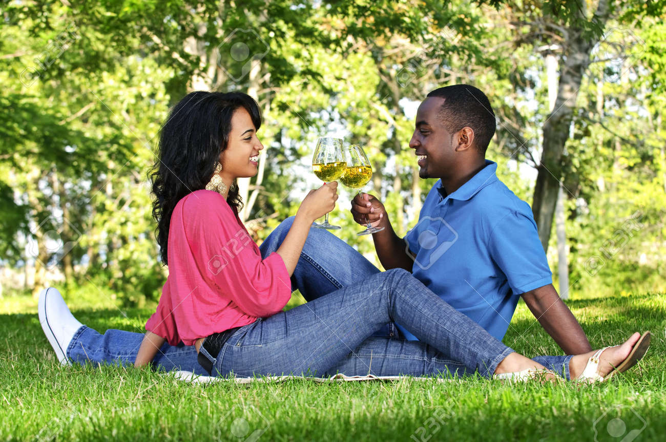 Young romantic couple celebrating with wine in summer park Stock Photo - 5594259