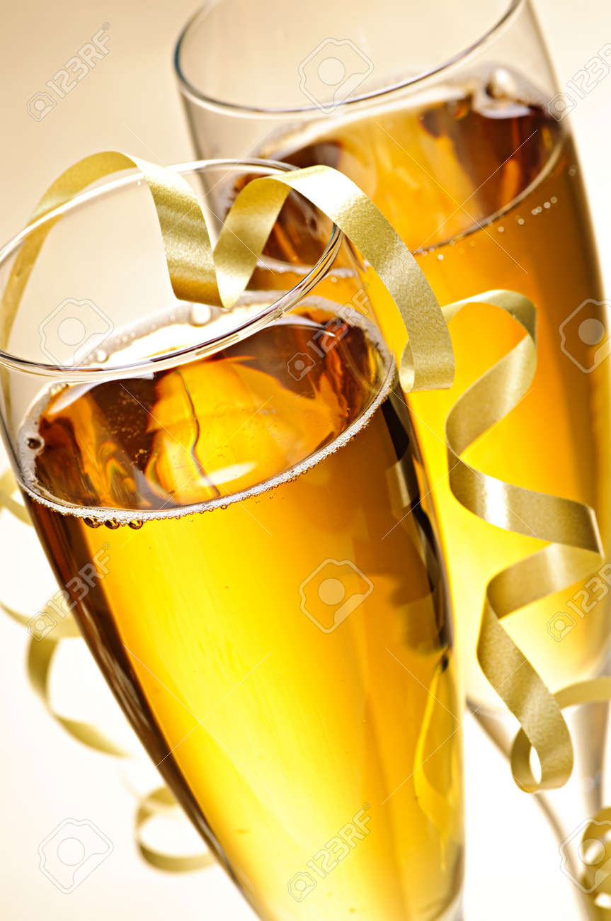 Two full champagne flutes with sparkling wine and ribbon Stock Photo - 5801307