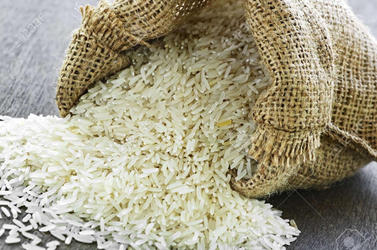 Raw long grain white rice grains in burlap bag Stock Photo - 6219906