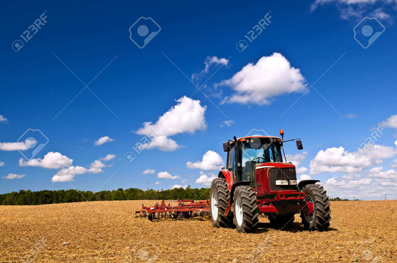 Small scale farming with tractor and plow in field Stock Photo - 6265673