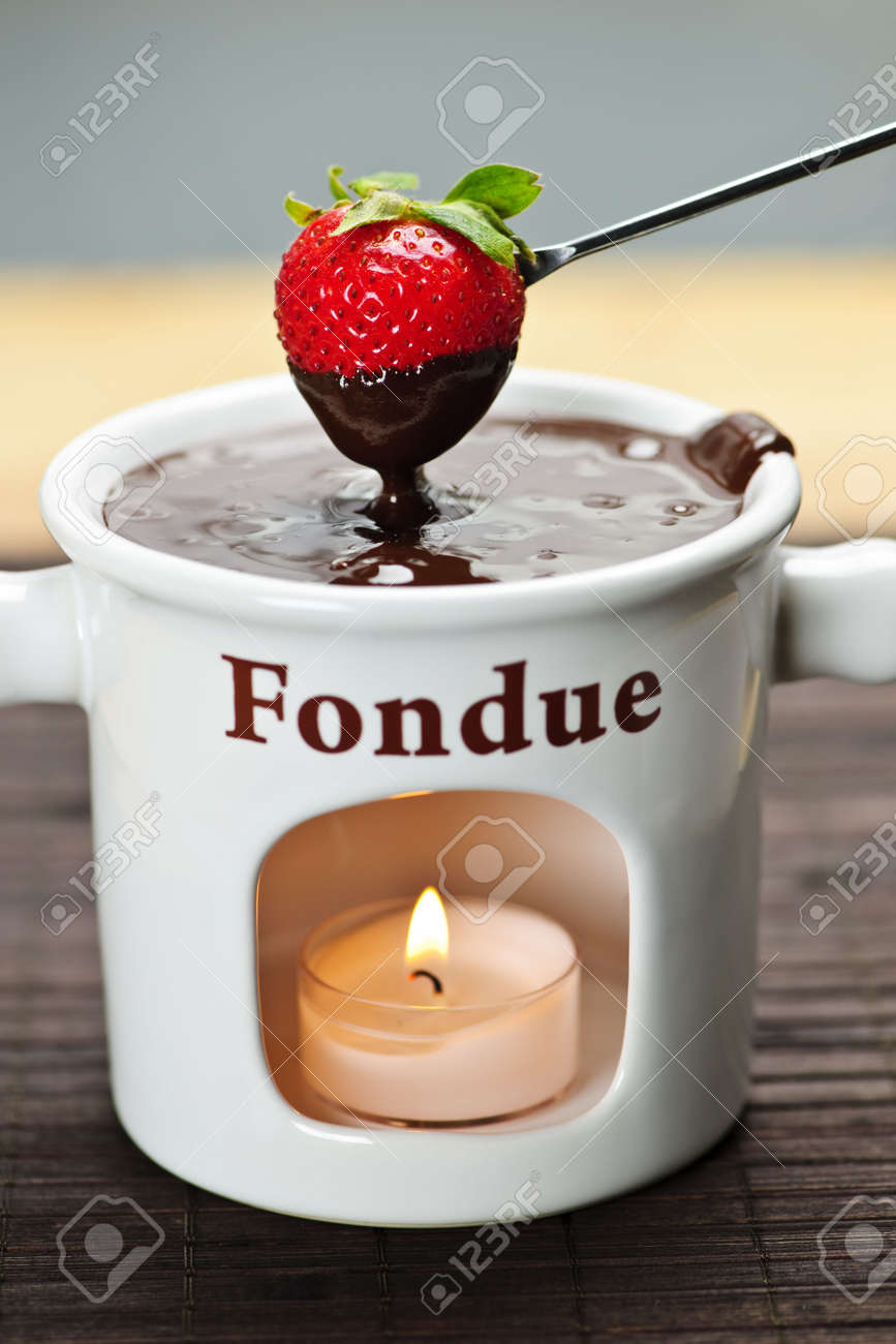 Strawberry Dipped In Delicious Melted Chocolate Fondue Stock Photo ...