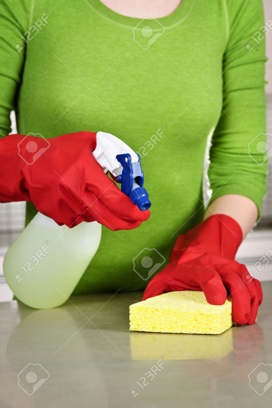 Girl cleaning kitchen  with sponge and rubber gloves Standard-Bild - 6477477
