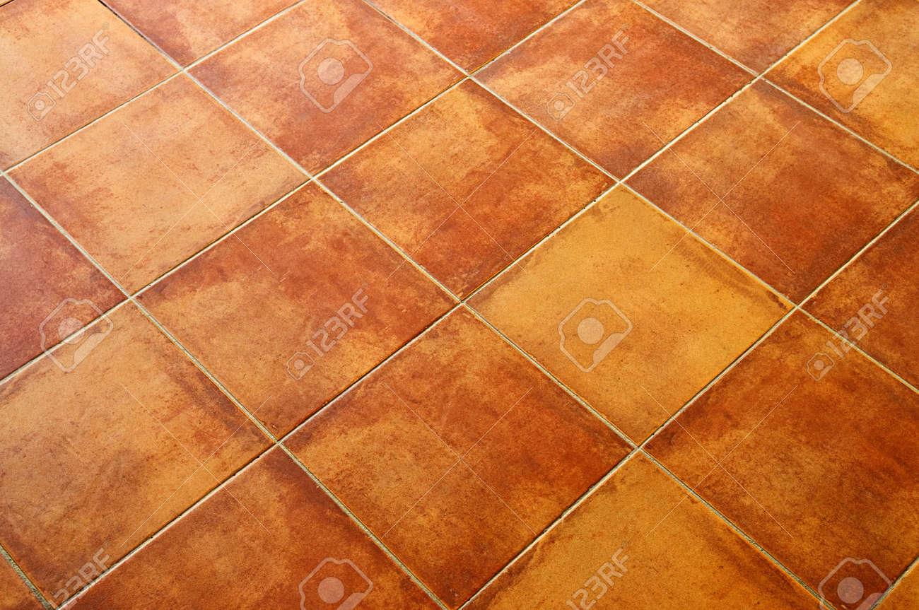 Closeup of square terracotta ceramic tile floor background stock closeup of square terracotta ceramic tile floor background stock photo 6555752 dailygadgetfo Images