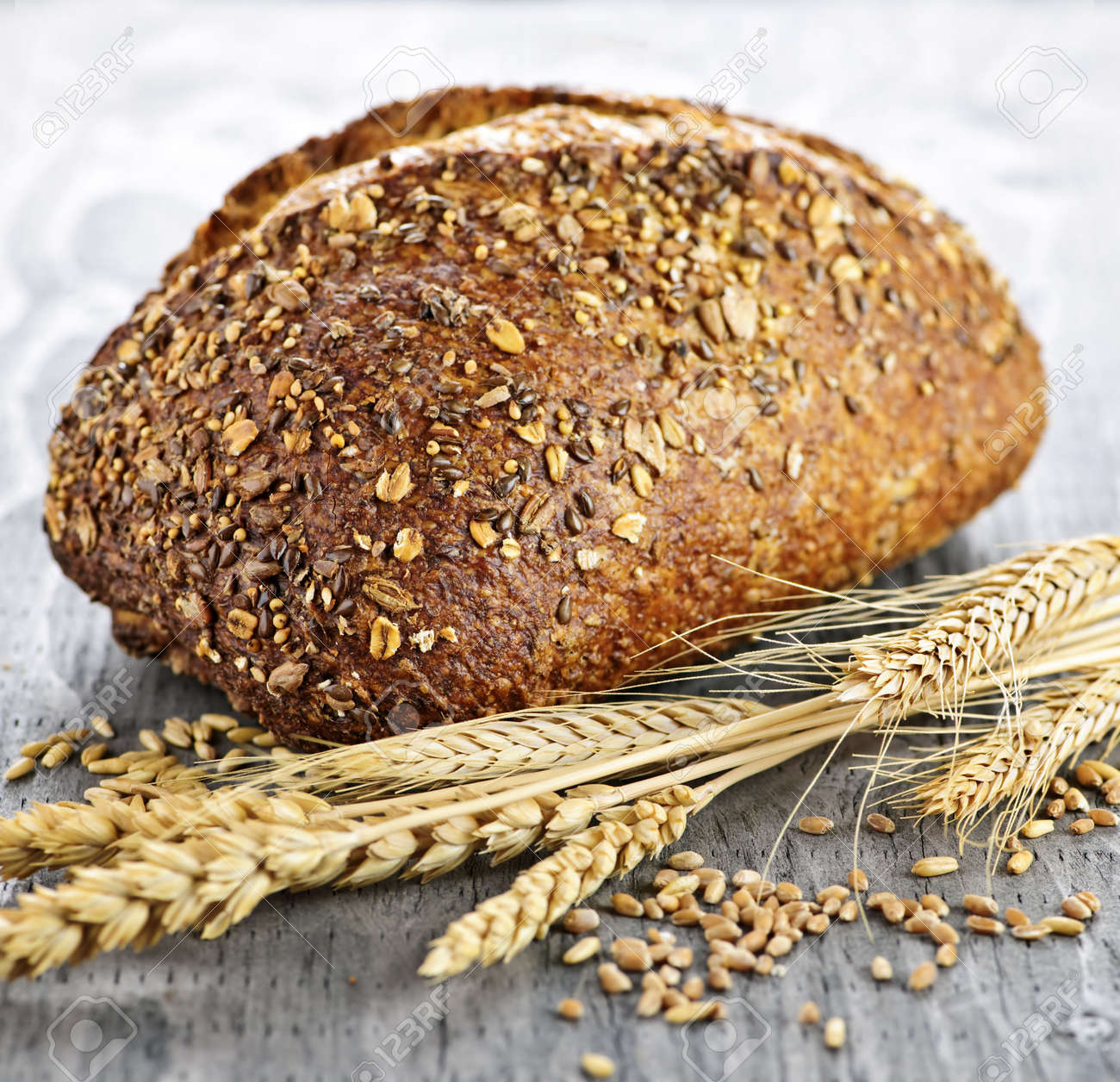 Loaf of fresh baked multigrain bread with grain ears Stock Photo - 6698373