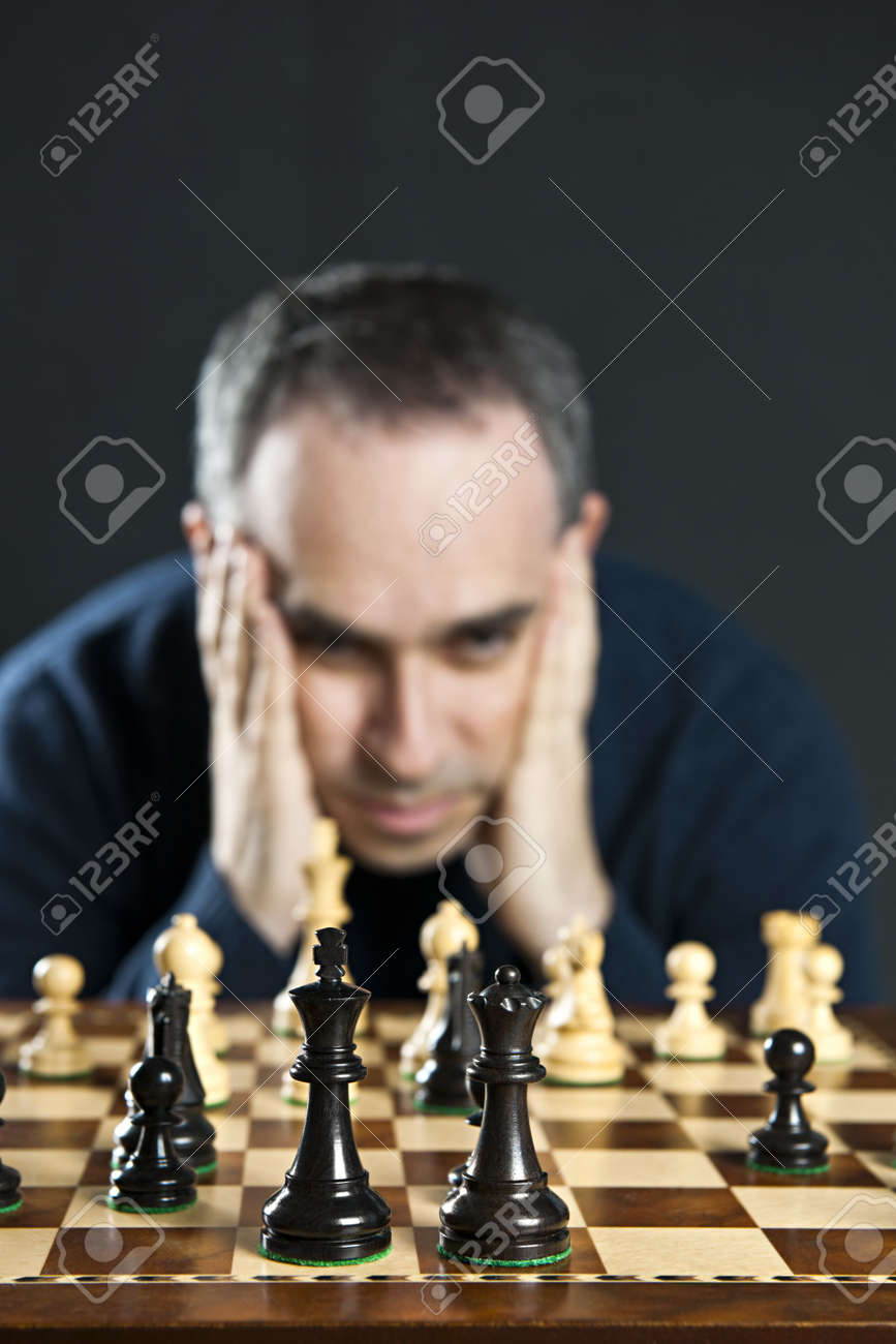 Chessboard with man thinking about chess strategy Stock Photo - 6856891