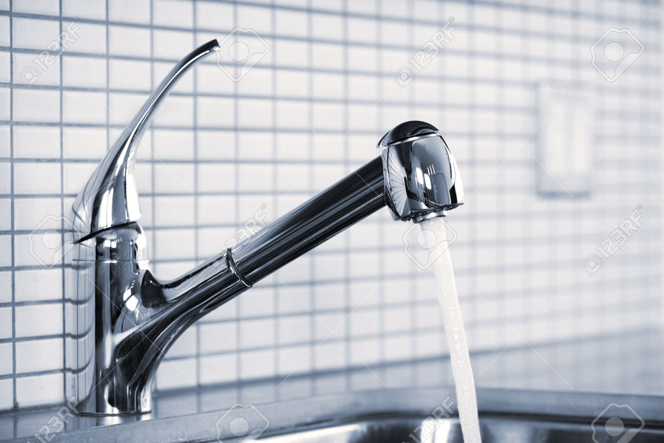 Attractive Stainless Steel Kitchen Faucet And Sink With Running Water Stock Photo    7305400