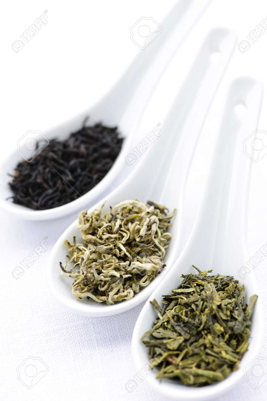 Black, white and green dry tea leaves in spoons Stock Photo - 7372934