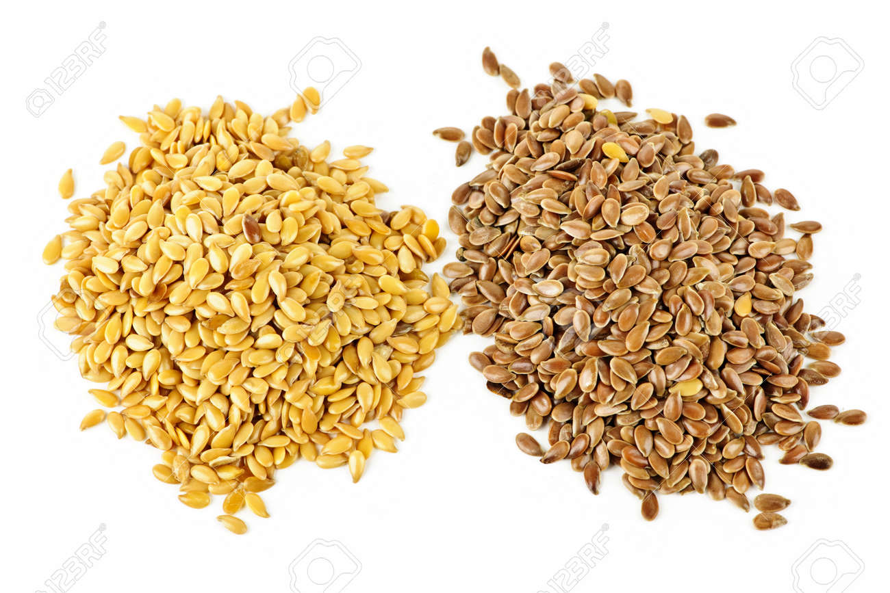 Heaps of brown and golden flax seed or linseed isolated on white background Stock Photo - 7701780