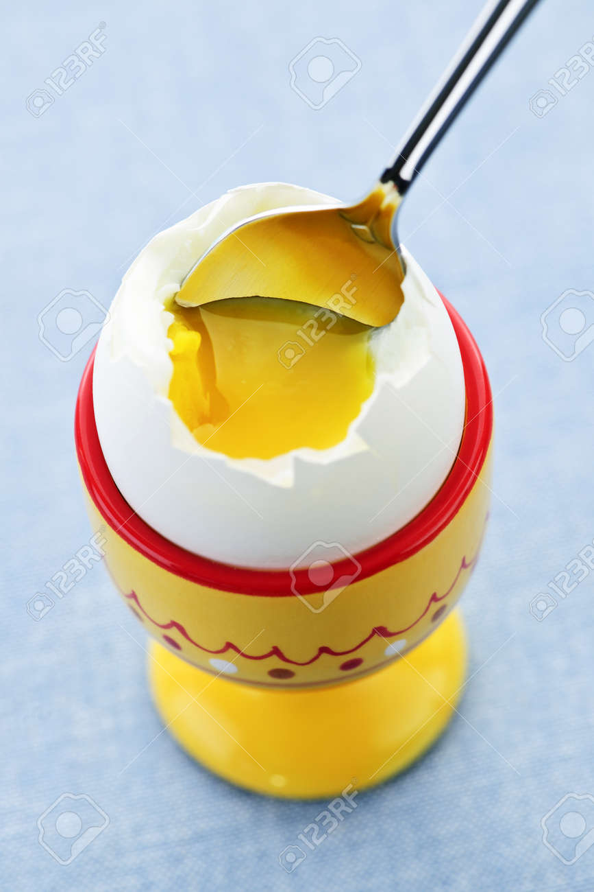 Closeup of soft boiled egg in cup with spoon Stock Photo - 7745771