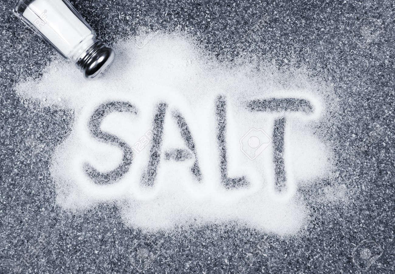 Salt written on counter in spilled salts from shaker Stock Photo - 7745802