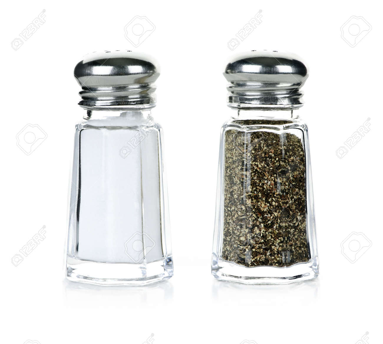 Glass salt and pepper shakers isolated on white background Stock Photo - 7745756