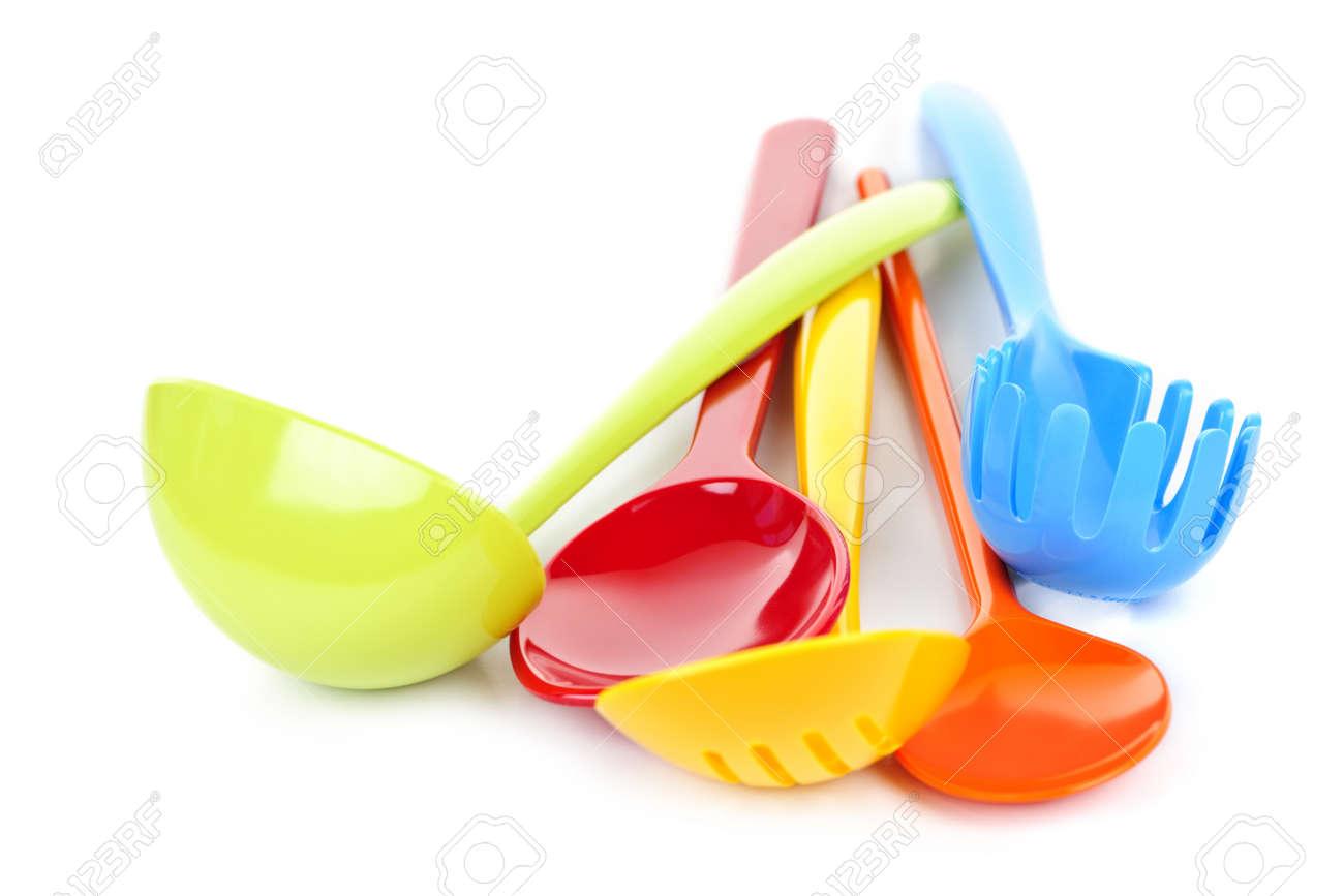 White Kitchen Utensils various colorful plastic kitchen utensils on white background