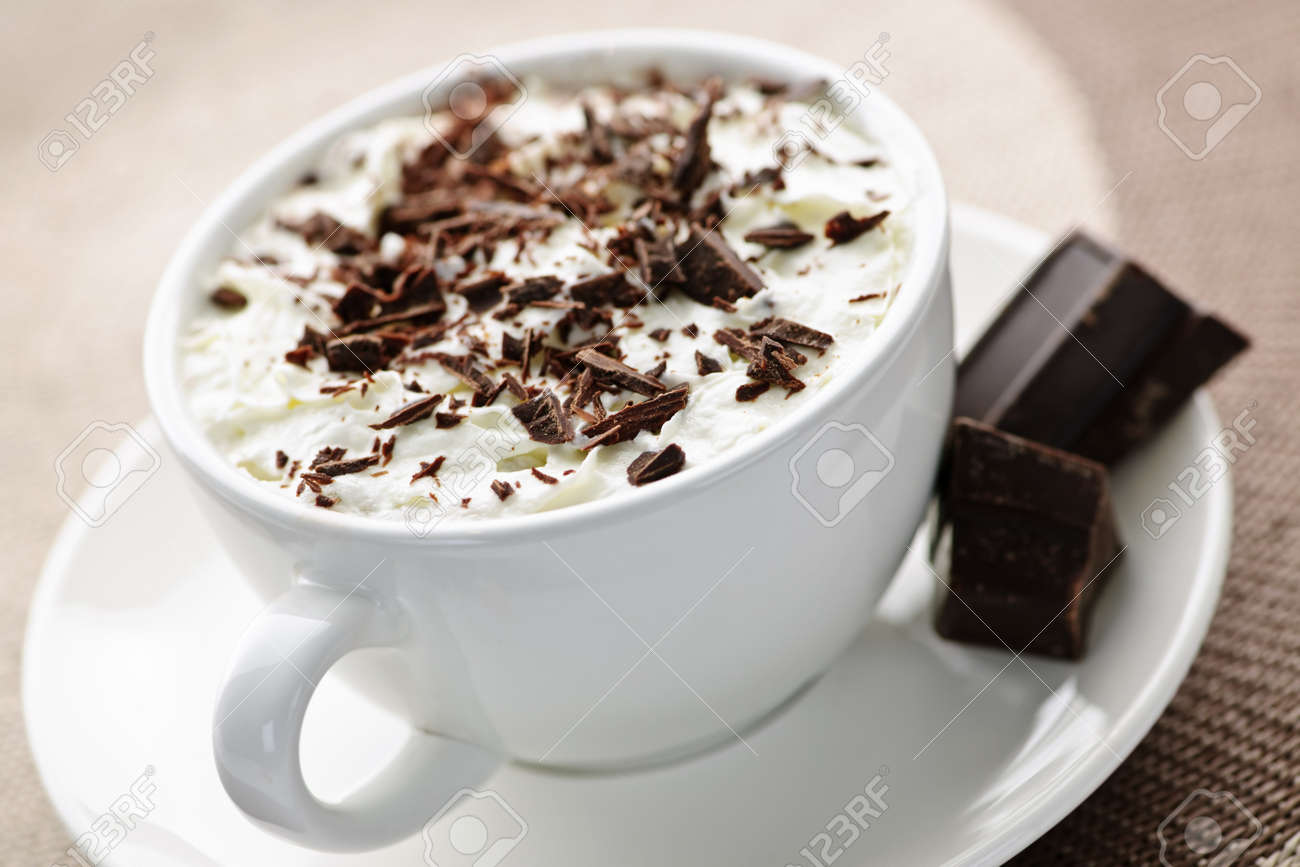 Cup of hot cocoa with shaved chocolate and whipped cream Stock Photo - 8066945