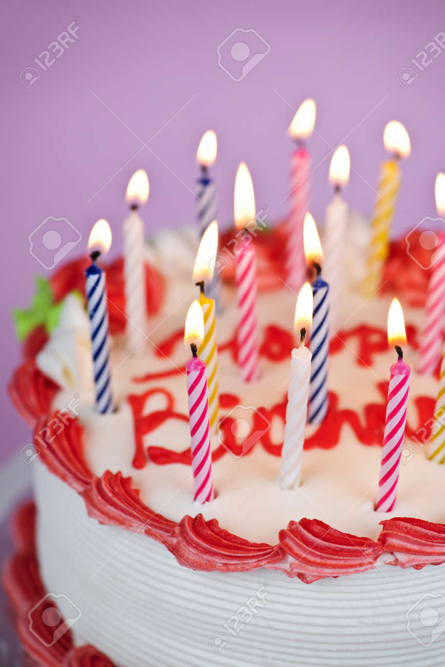 Birthday cake with burning candles and icing Stock Photo - 8163217