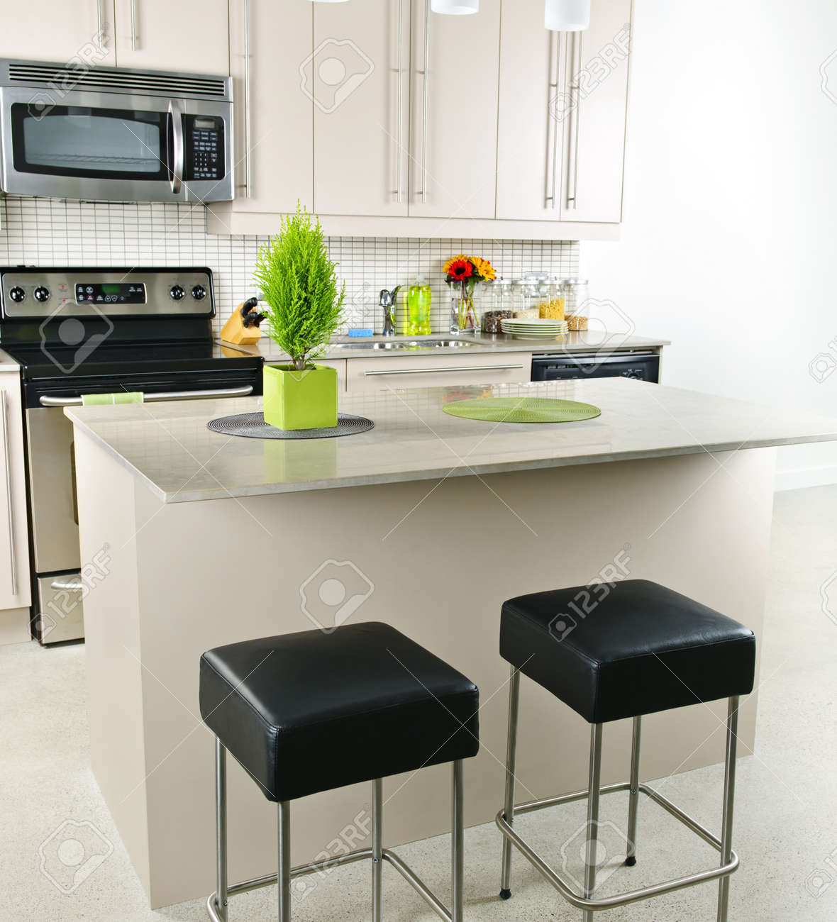 Modern kitchen interior with island and natural stone countertop Stock Photo - 8163221