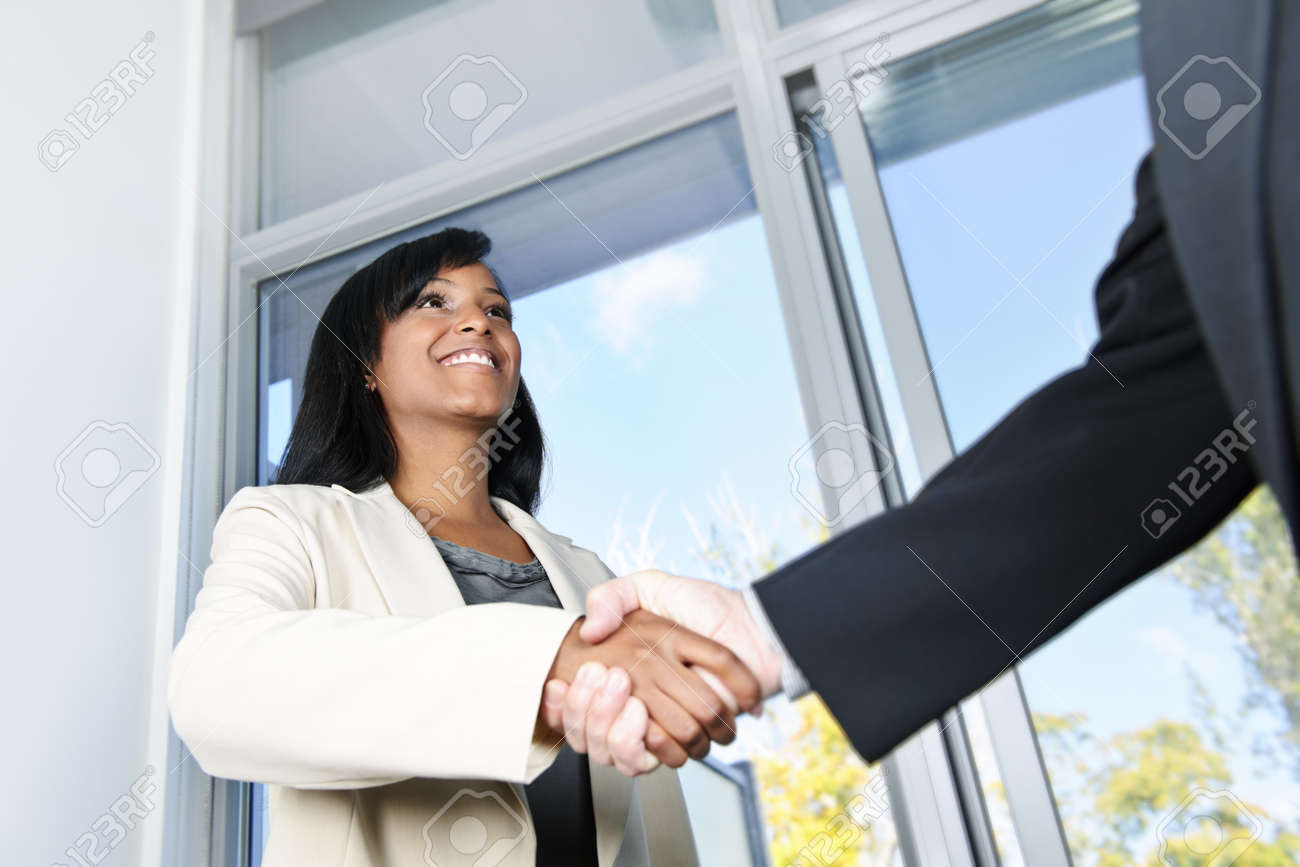 Portrait of black business woman shaking hands Stock Photo - 8436656