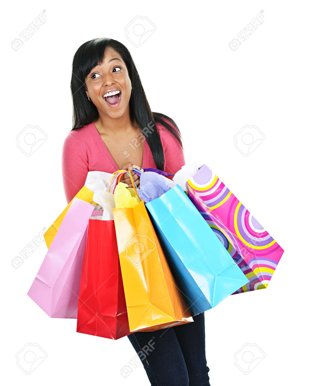 Young happy excited black woman holding shopping bags Stock Photo - 8436652