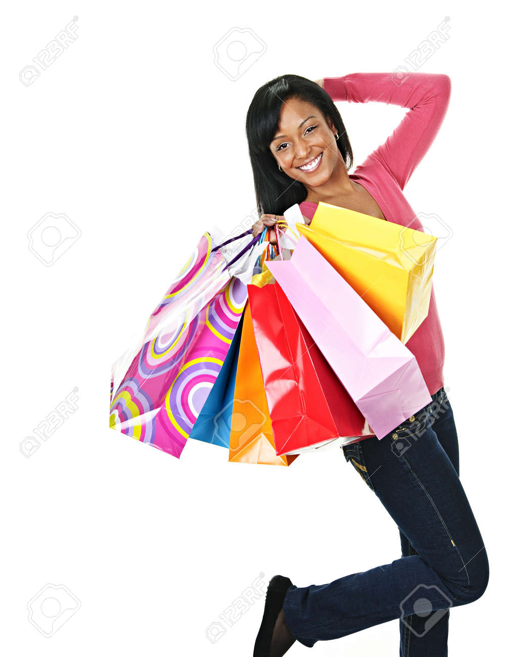 Young excited smiling black woman holding shopping bags Stock Photo - 8436654