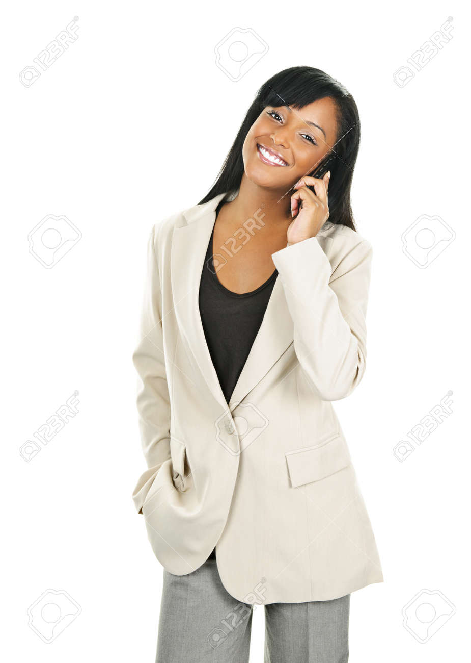 Young smiling black businesswoman on cell phone isolated on white background Stock Photo - 9240553