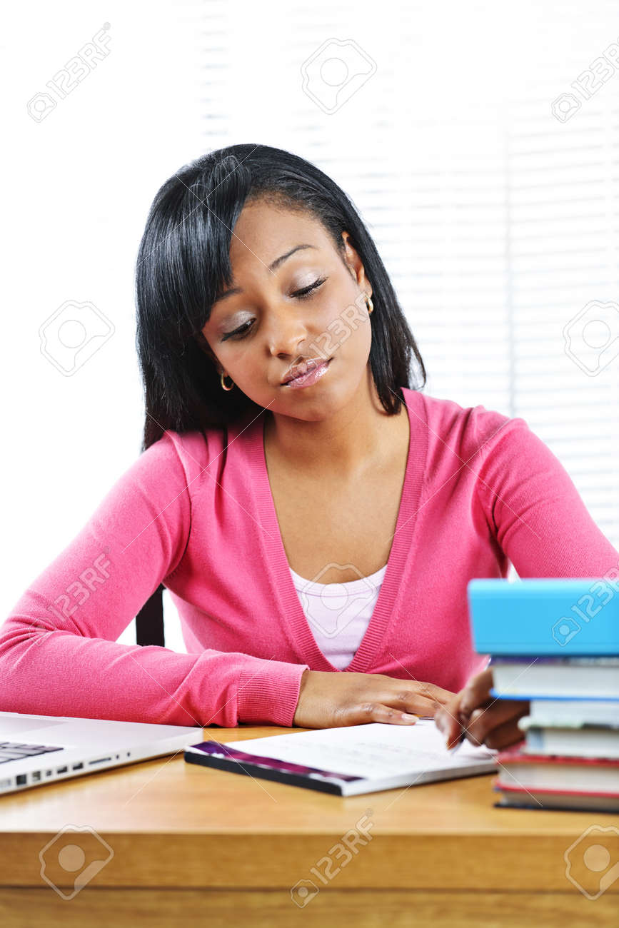 Young black female student studying at desk looking sad Stock Photo - 9240561