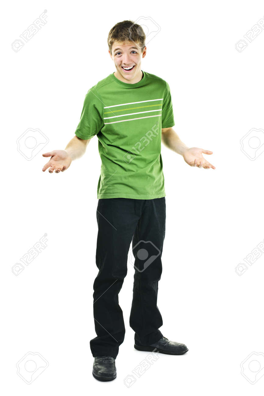 Shrugging smiling young man standing isolated on white background Stock Photo - 9304025