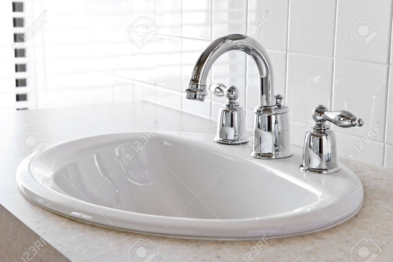 Bathroom interior with white sink and faucet Stock Photo - 9417866