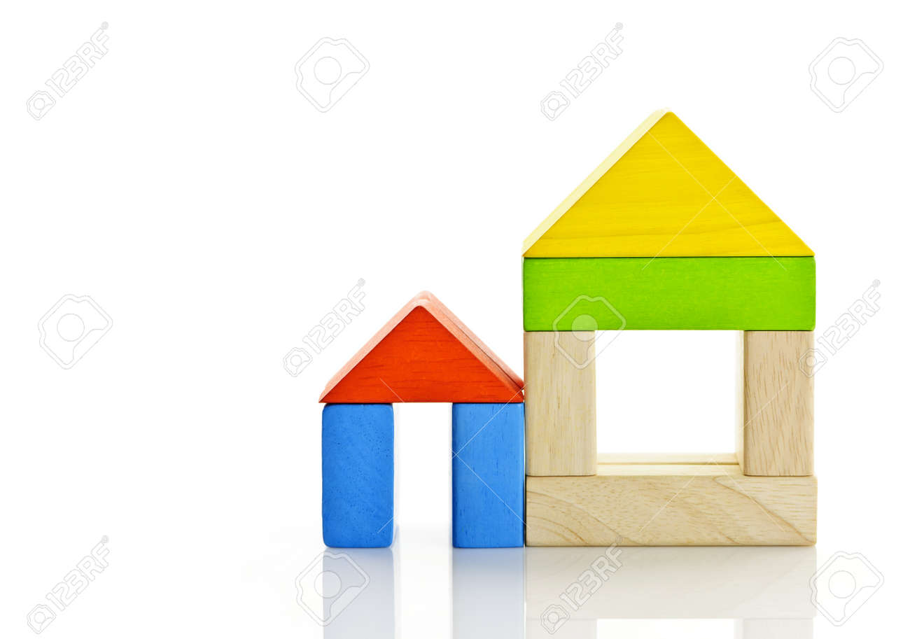 Houses built out of toy wooden building blocks Stock Photo - 9431774