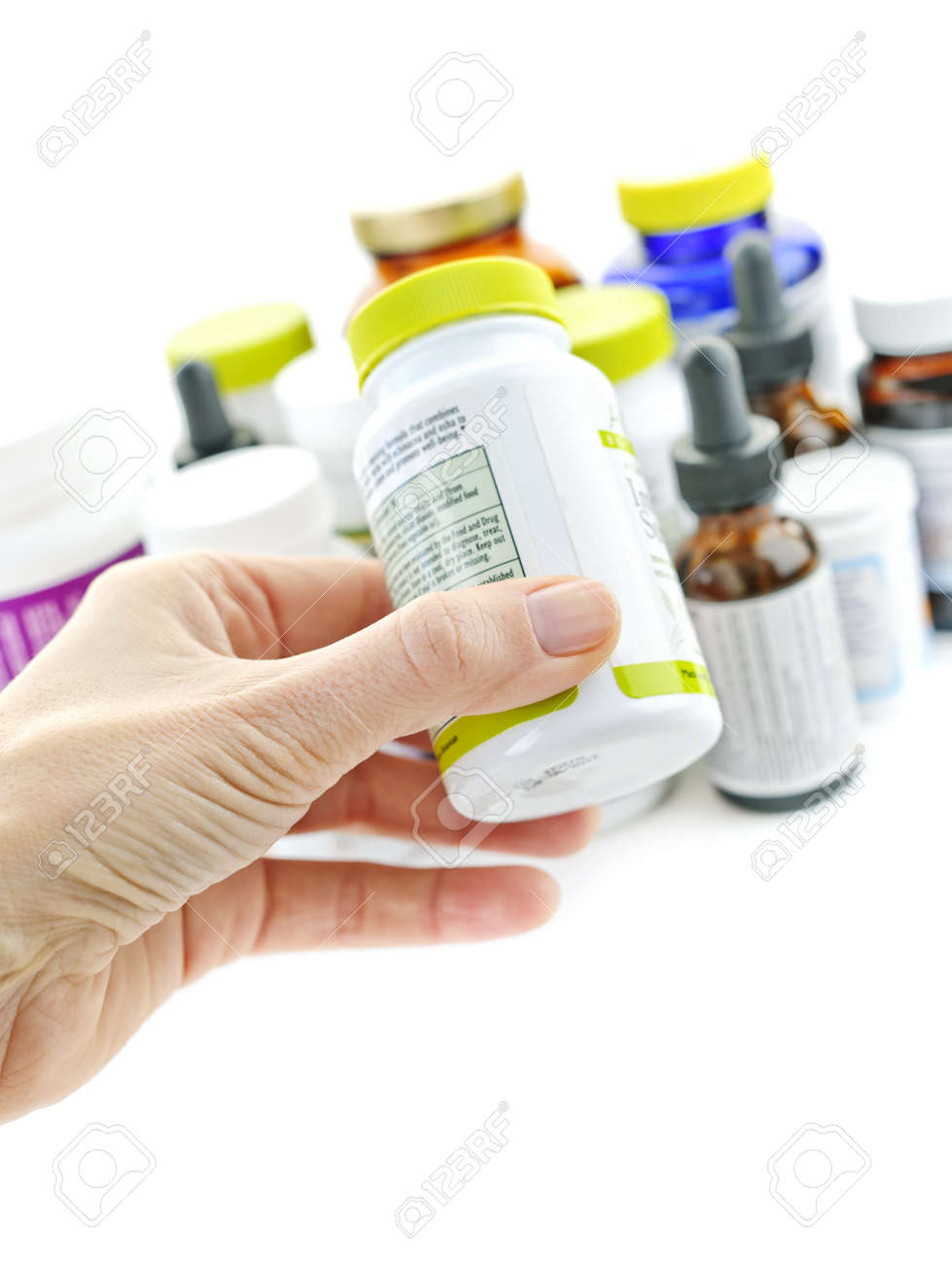 Hand holding medicine bottle to read label Stock Photo - 9431871