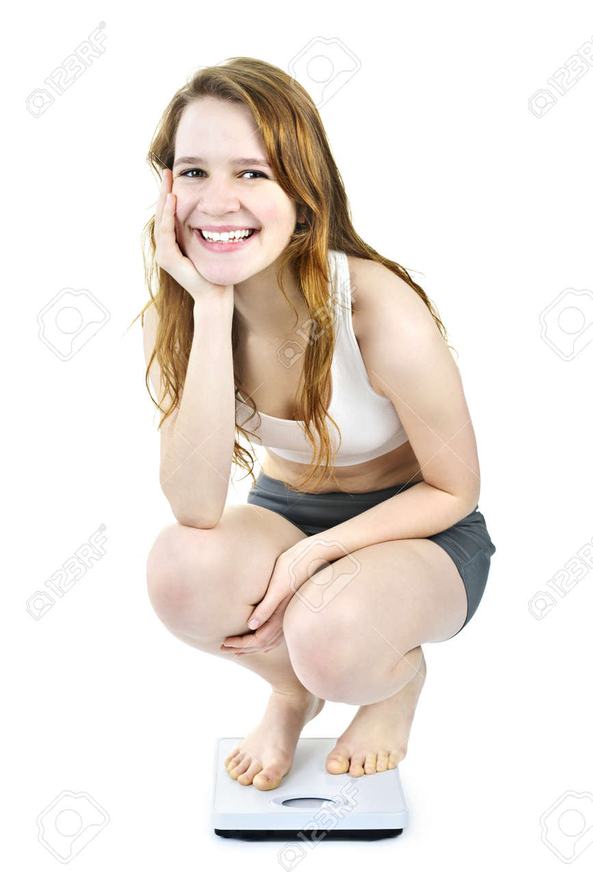 Healthy happy young woman crouching on bathroom scale isolated on white Stock Photo - 9434390