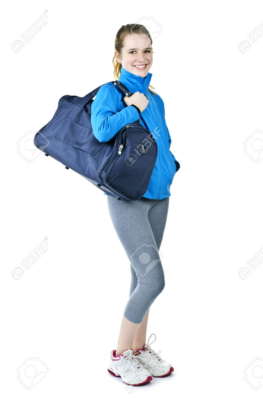 Happy fit young woman with gym bag standing ready for fitness exercise Stock Photo - 9559350