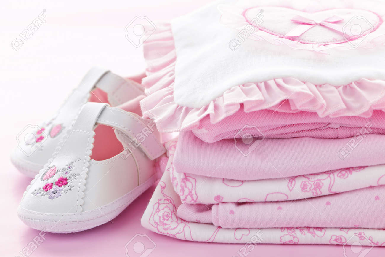 Pink infant girl clothing and shoes for baby shower Stock Photo - 9660696