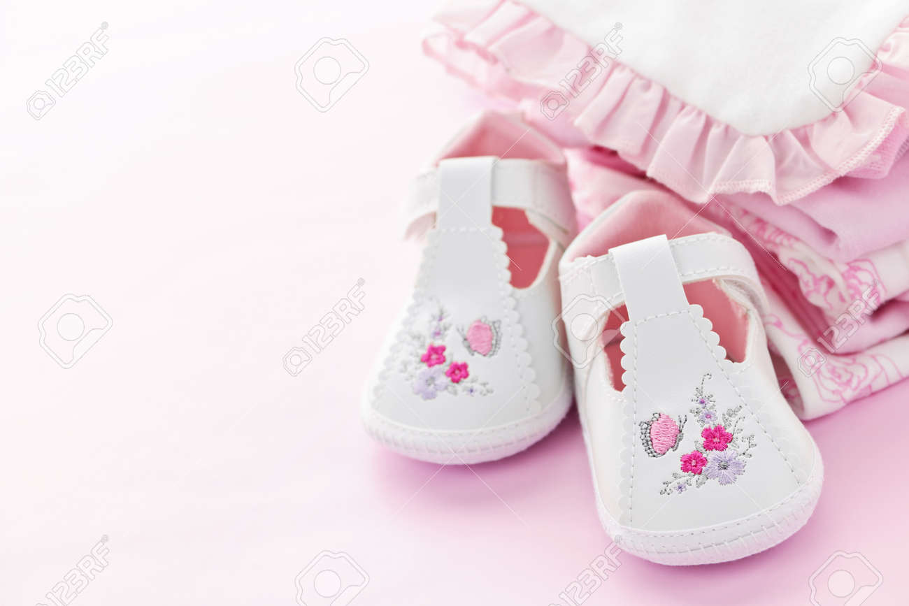 a7660d492f46d Infant girl clothing and shoes for baby shower on pink background Stock  Photo - 9660663
