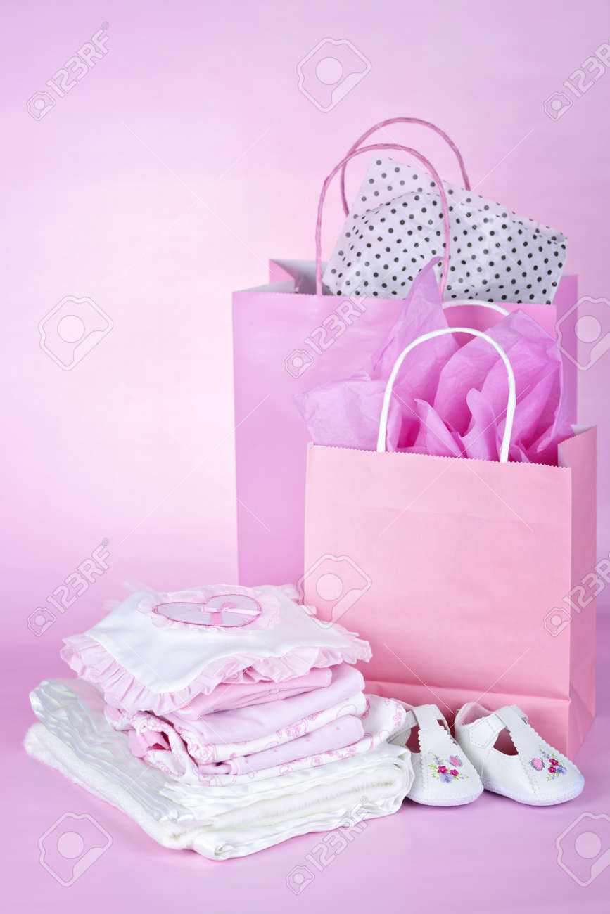 Gift bags and infant clothes for girl baby shower on pink background Stock Photo - 9734584 & Gift Bags And Infant Clothes For Girl Baby Shower On Pink Background ...